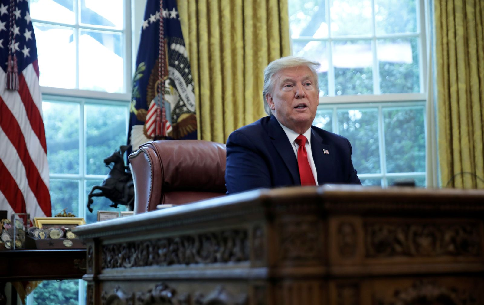 U.S. President Trump answers questions during an interview with Reuters in the Oval Office of the White House in Washington