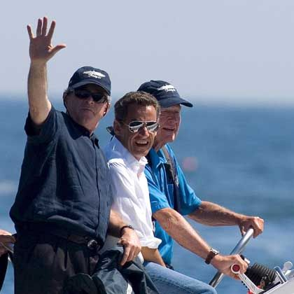 A heartfelt and manly outing: US President George W. Bush and French President Nicolas Sarkozy ride on Fidelity III with former US President George H.W. Bush off the coast of Kennebunkport, Maine.