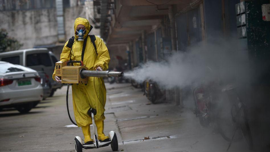 Desinfektionsarbeiter in Wuhan: Was jetzt entschieden wird, setzt Standards für morgen