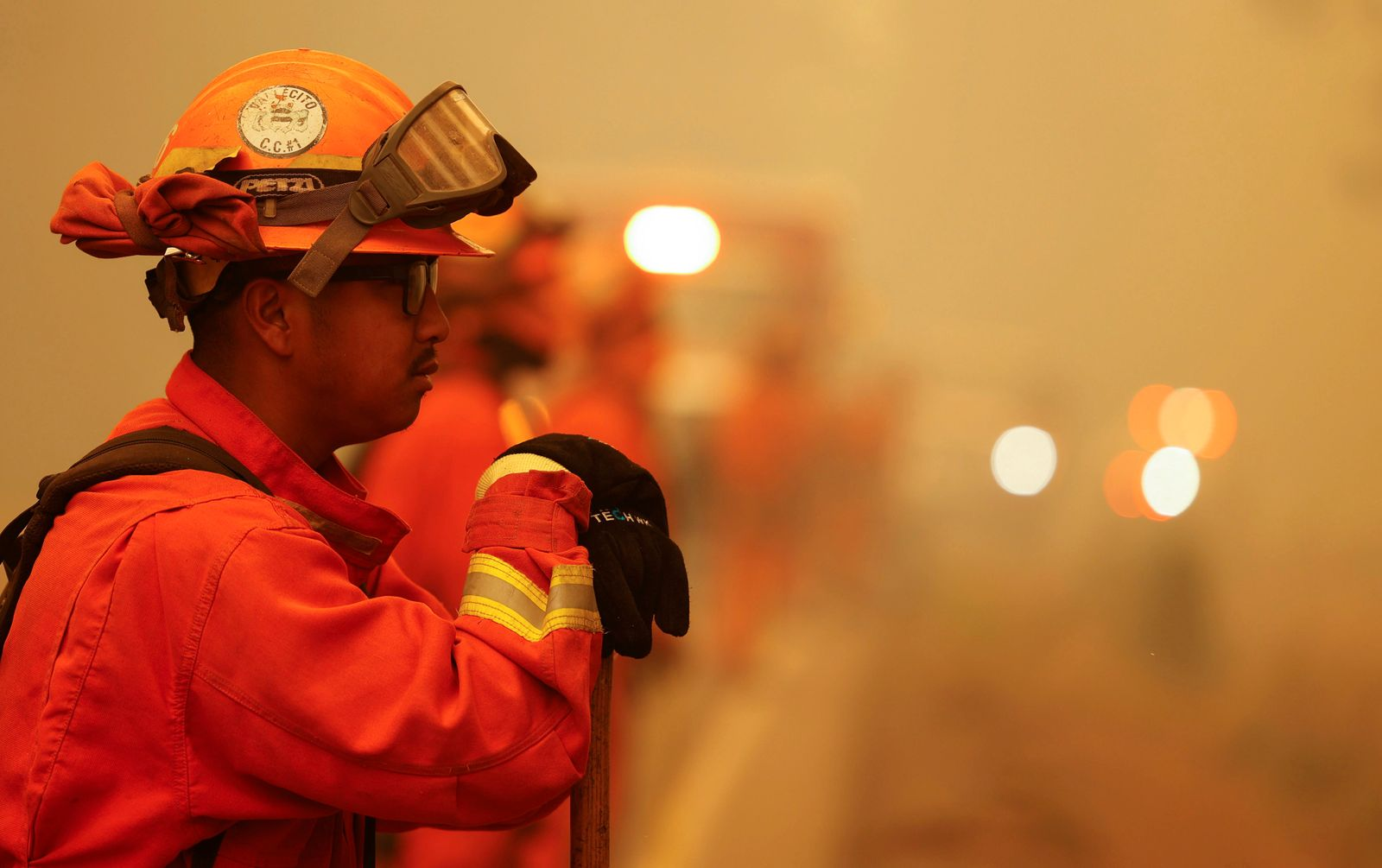 Inmate firefighters watch for spot fires of the Dixie Fire, in Westwood