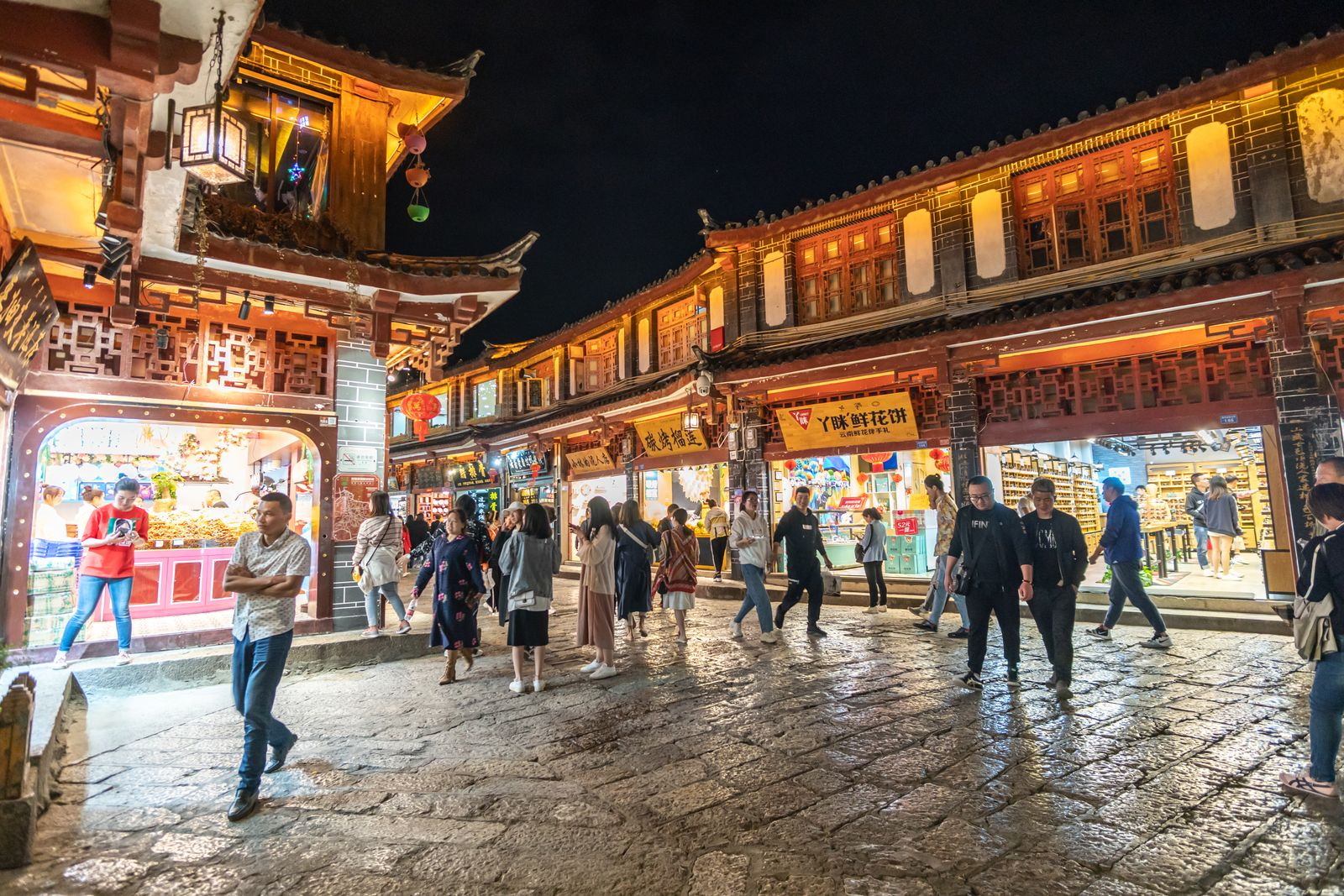 Crowd of tourist walking at old town of Lijiang(UNESCO World heritage site) a famous landmark in Lijiang, Yunnan, China.