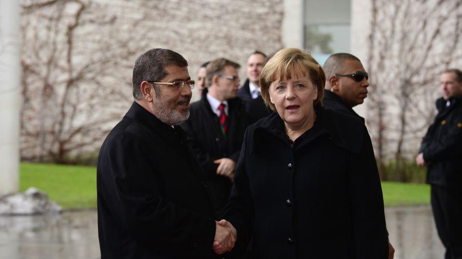 German Chancellor Merkel (right) gave Egyptian President Morsi advice on Wednesday, but no money.