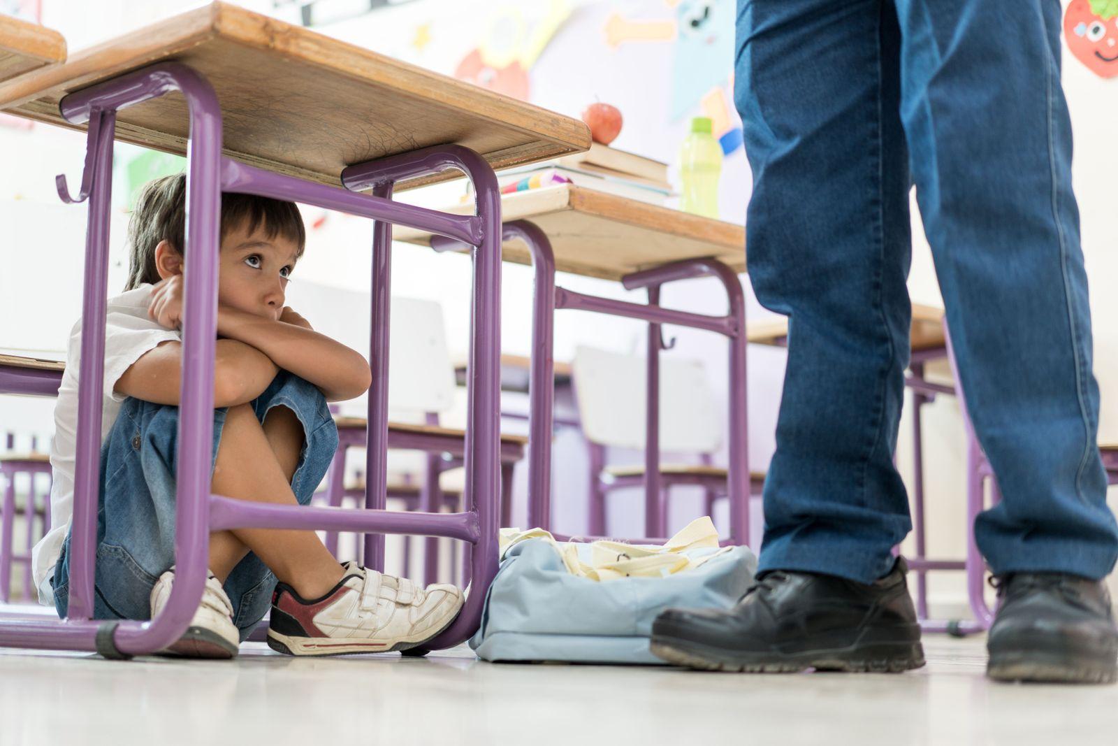 Scared kid in school