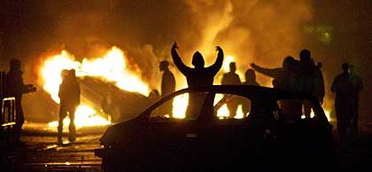 French youths rioting in the Paris suburbs in 2005. Many of those involved had immigrant backgrounds and some were Muslims.
