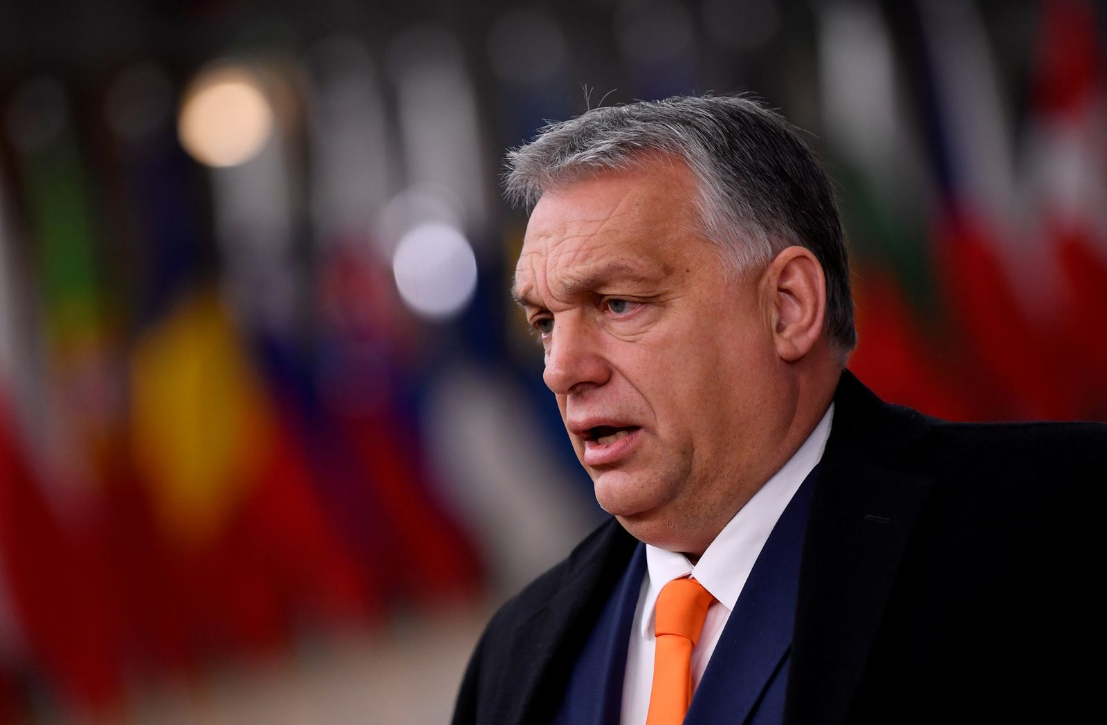 FILE PHOTO: Hungary's Prime Minister Viktor Orban speaks on arrival for an EU summit in Brussels