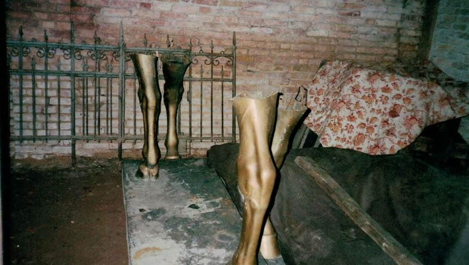The sawed-off legs of two monumental horses cast by Nazi sculptor Josef Thorak are seen here where they were hidden near East Berlin in 1989.