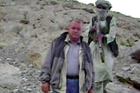 Rudolf Blechschmidt in a frame grab from a video broadcast by Al-Jazeera on July 31. His partner Rüdiger Dietrich died during a forced march on July 20.