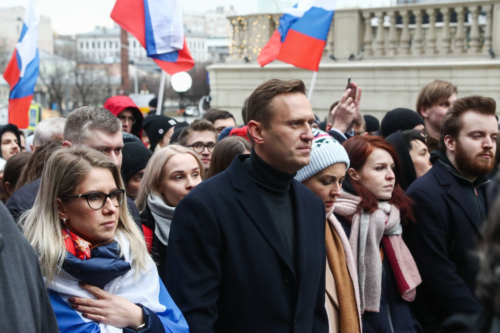 MOSCOW, RUSSIA - FEBRUARY 29, 2020: Opposition activists Lyubov Sobol (L) and Alexei Navalny with wife Yulia (C) take p
