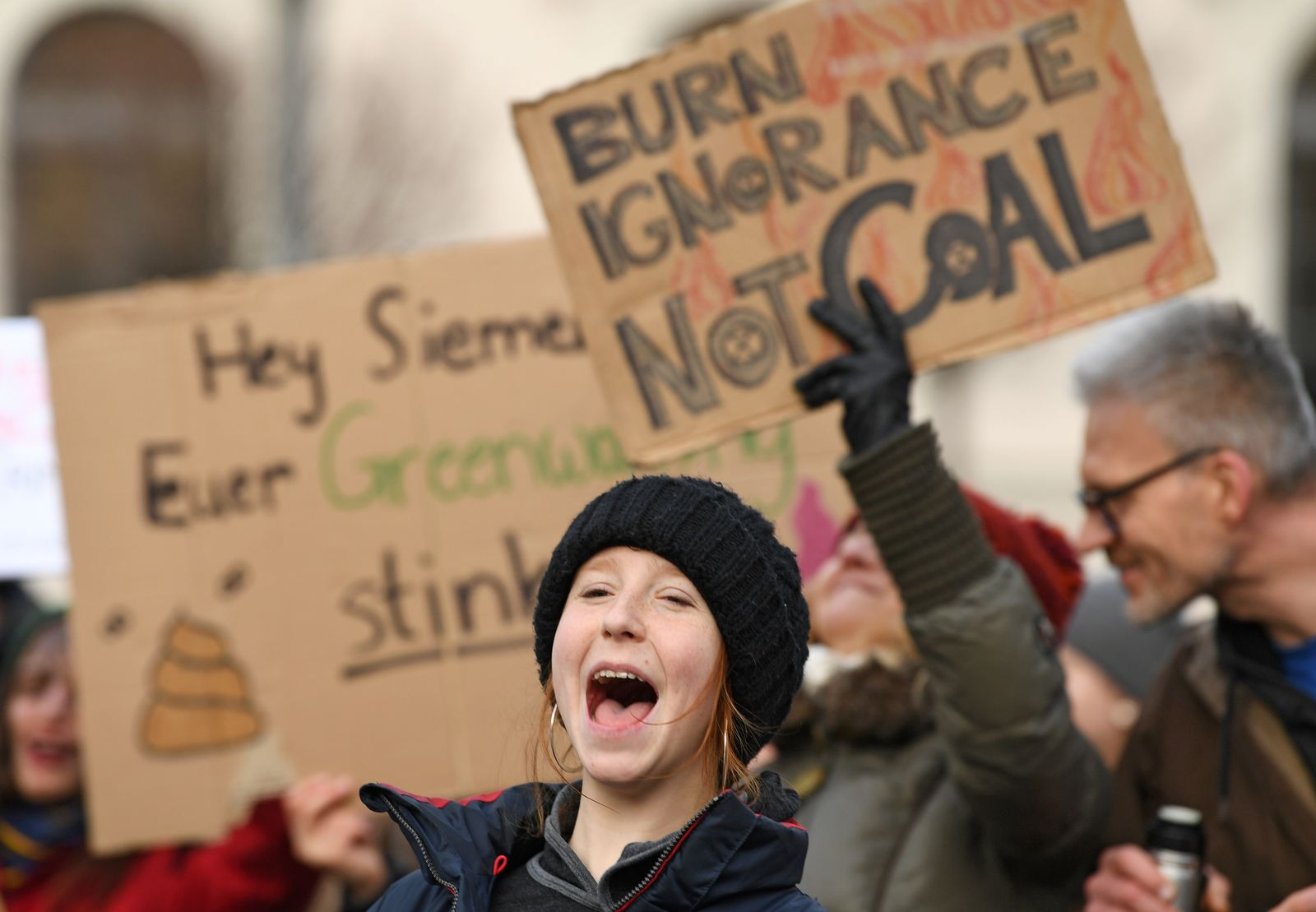 Fridays for Future activists take part in a protest in front of the Siemens headquarters in Munich