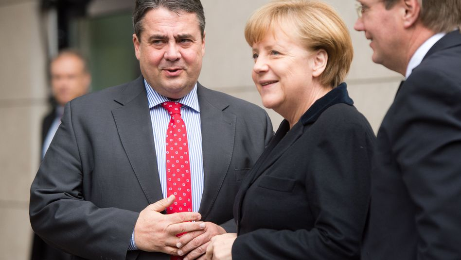 Merkel with SPD leader Sigmar Gabriel ahead of talks on Monday.