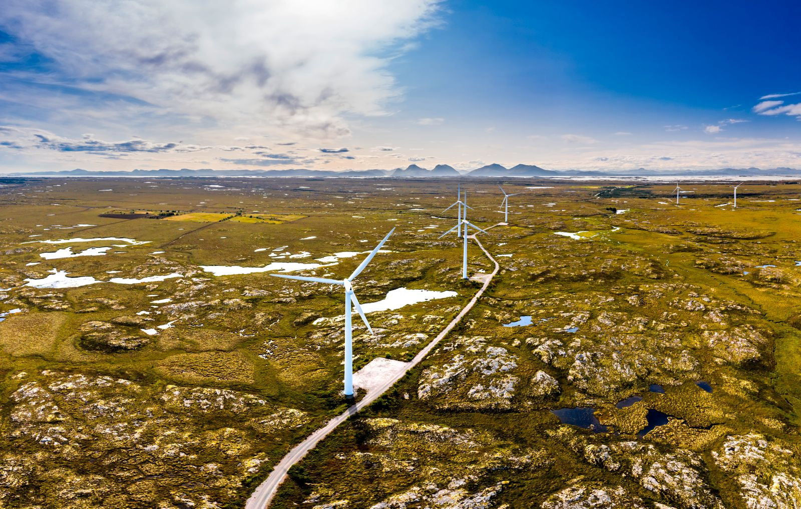 Wind generators in the arctic tundra. Norway, Smola island. Aerial view.