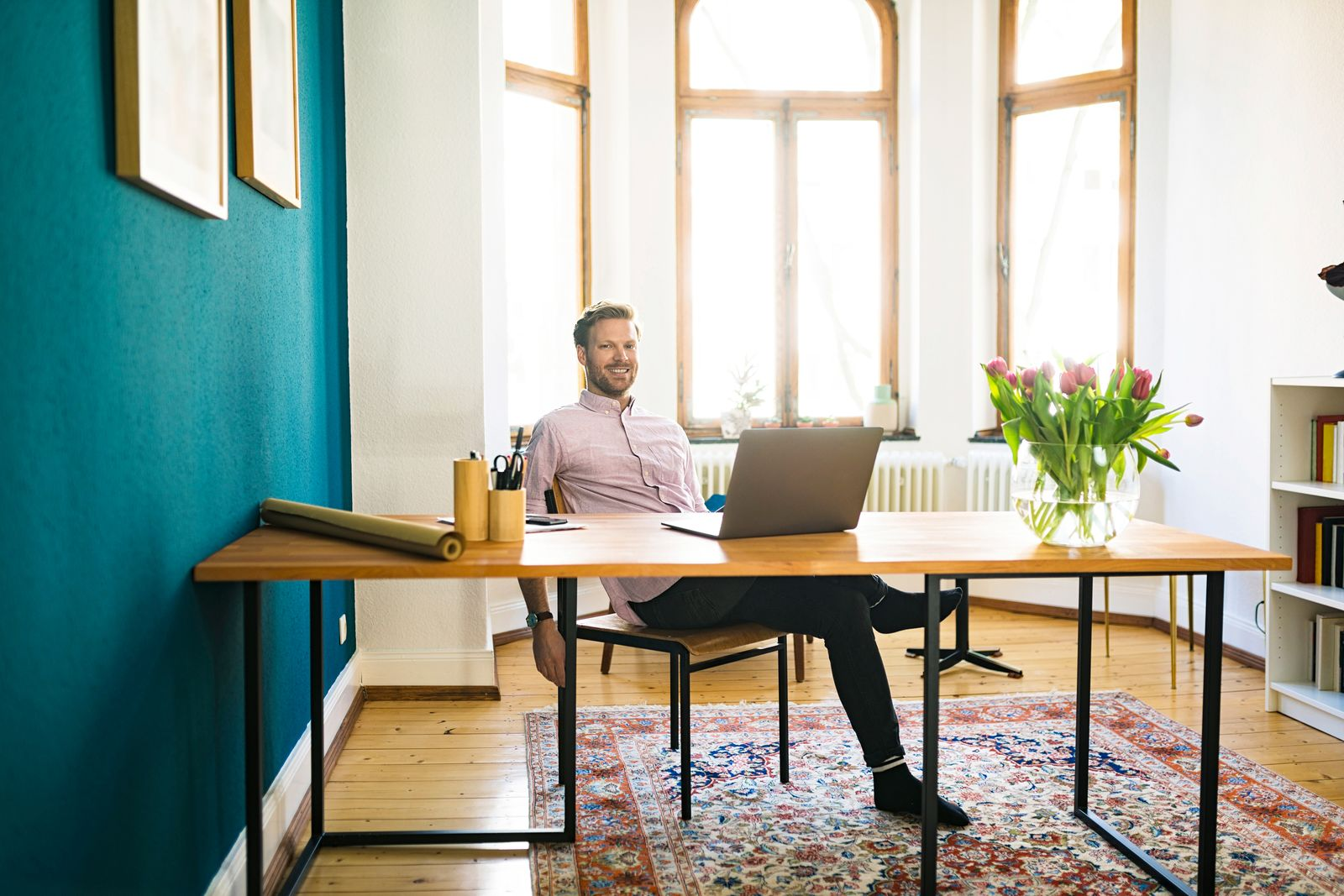 Portrait of happy relaxed casual businessman in home office
