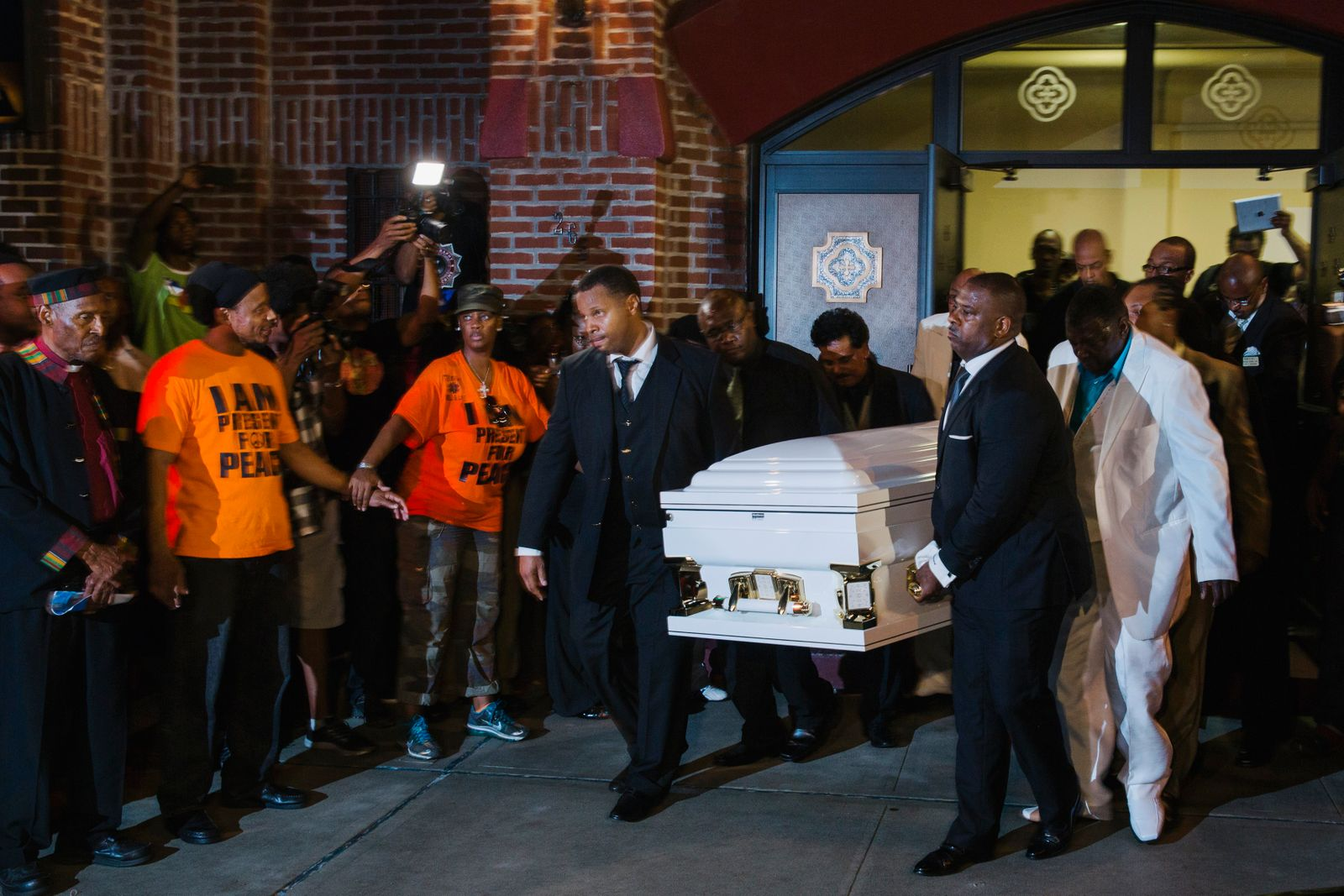 Pallbearers carry the casket of Garner out of the Bethel Baptist Church following his funeral in New York