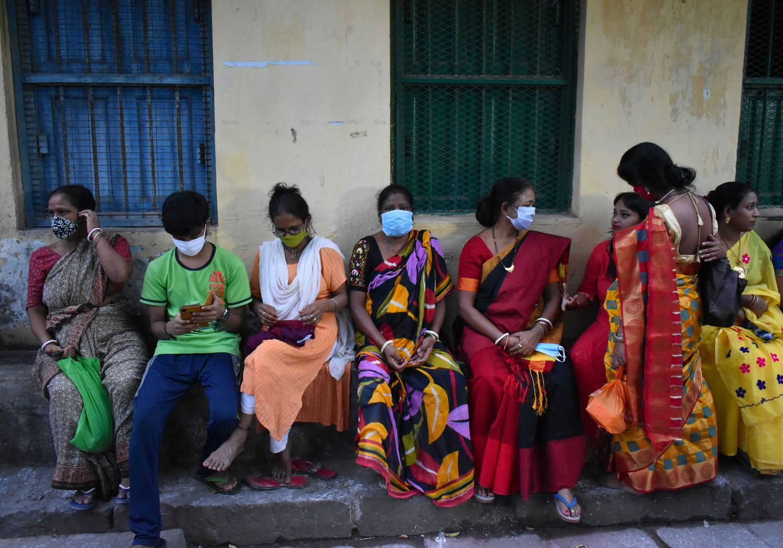 Crowd and Covid-19 in India People are sitting beside the road without maintaining social distancing and some are not we
