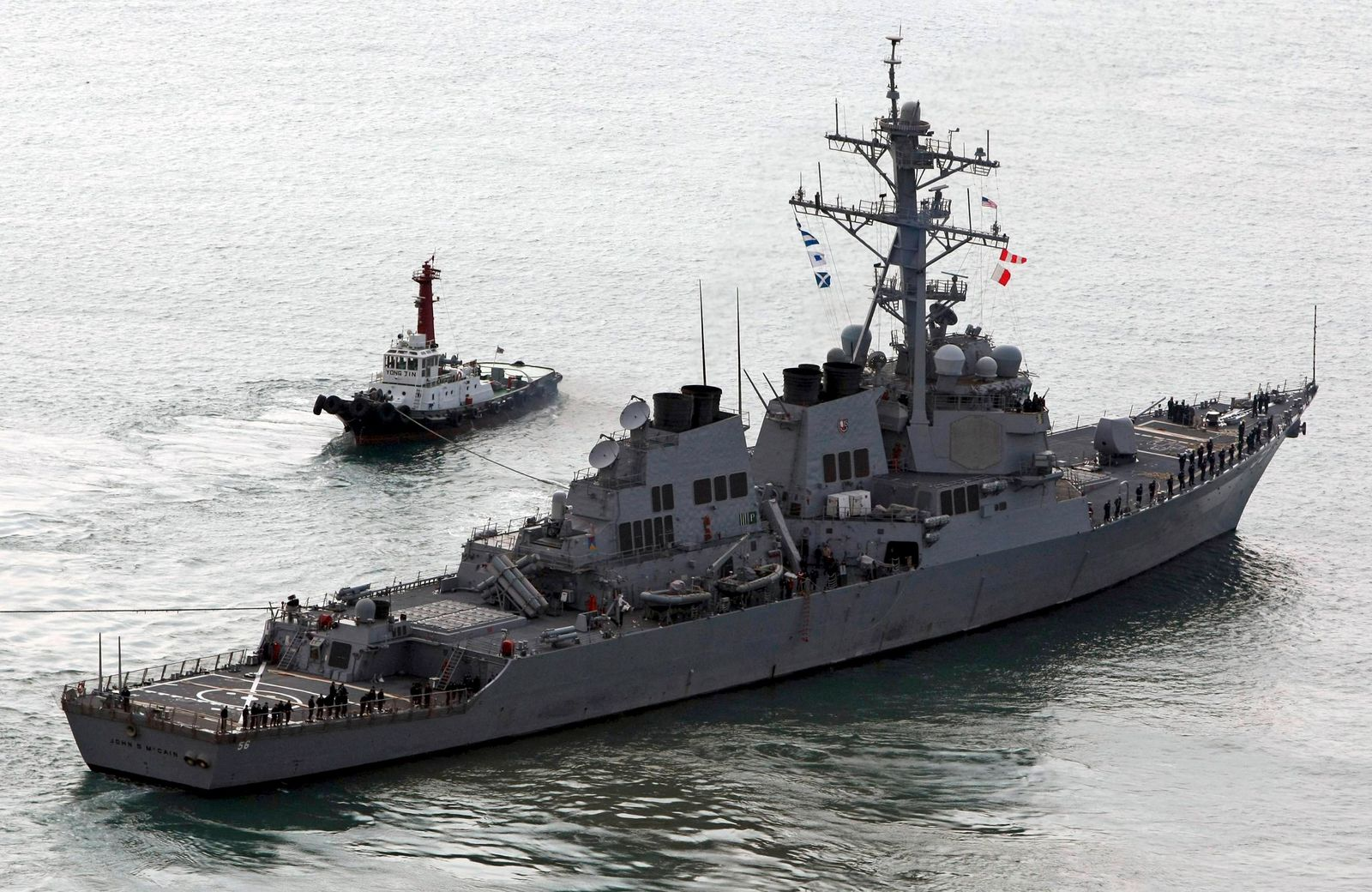 U.S. Navy's guided-missile destroyer USS John S. McCain sails off a naval port in Busan