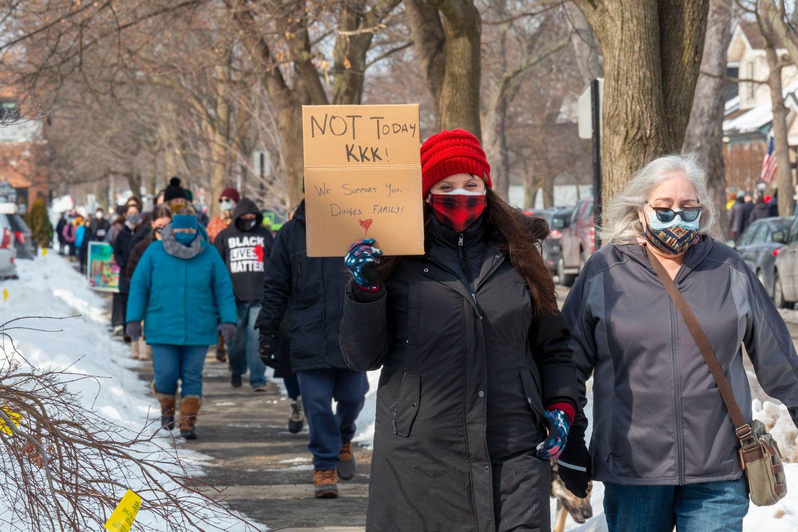 February 21, 2021, Grosse Pointe Park, Michigan, USA: Grosse Pointe Park, Michigan - Several hundred people marched pas