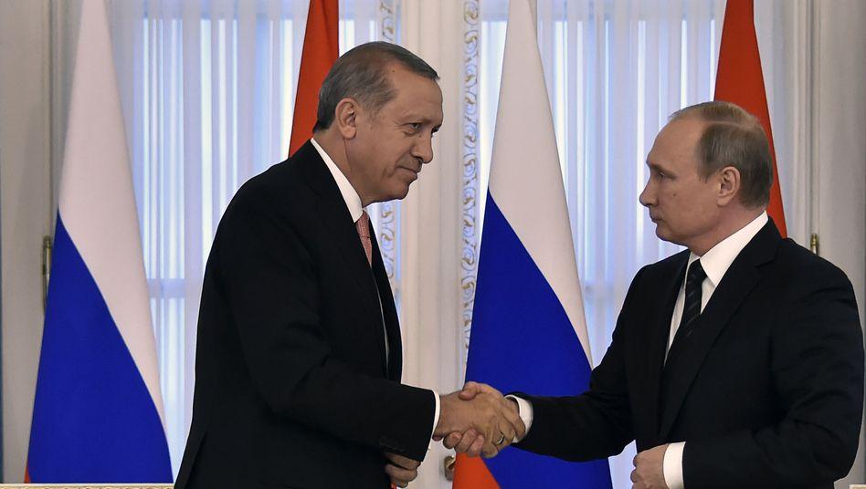 Präsidenten Erdogan (links), Putin