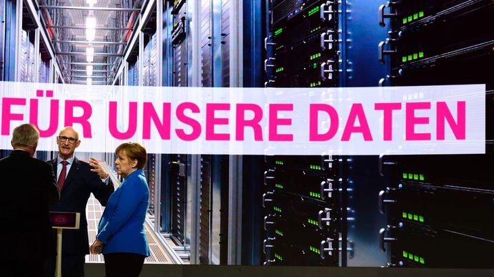 Angela Merkel und Telekom-CEO Timotheus Höttges