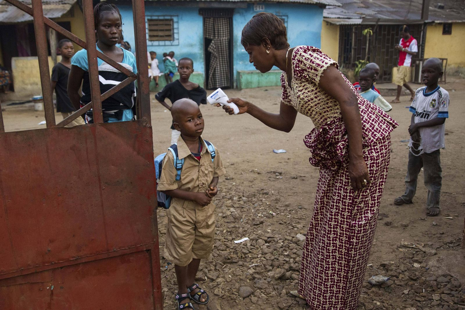 Jan. 27, 2015 - Conakry, Guinea - A young school boy has his temperature checked for the Ebola virus