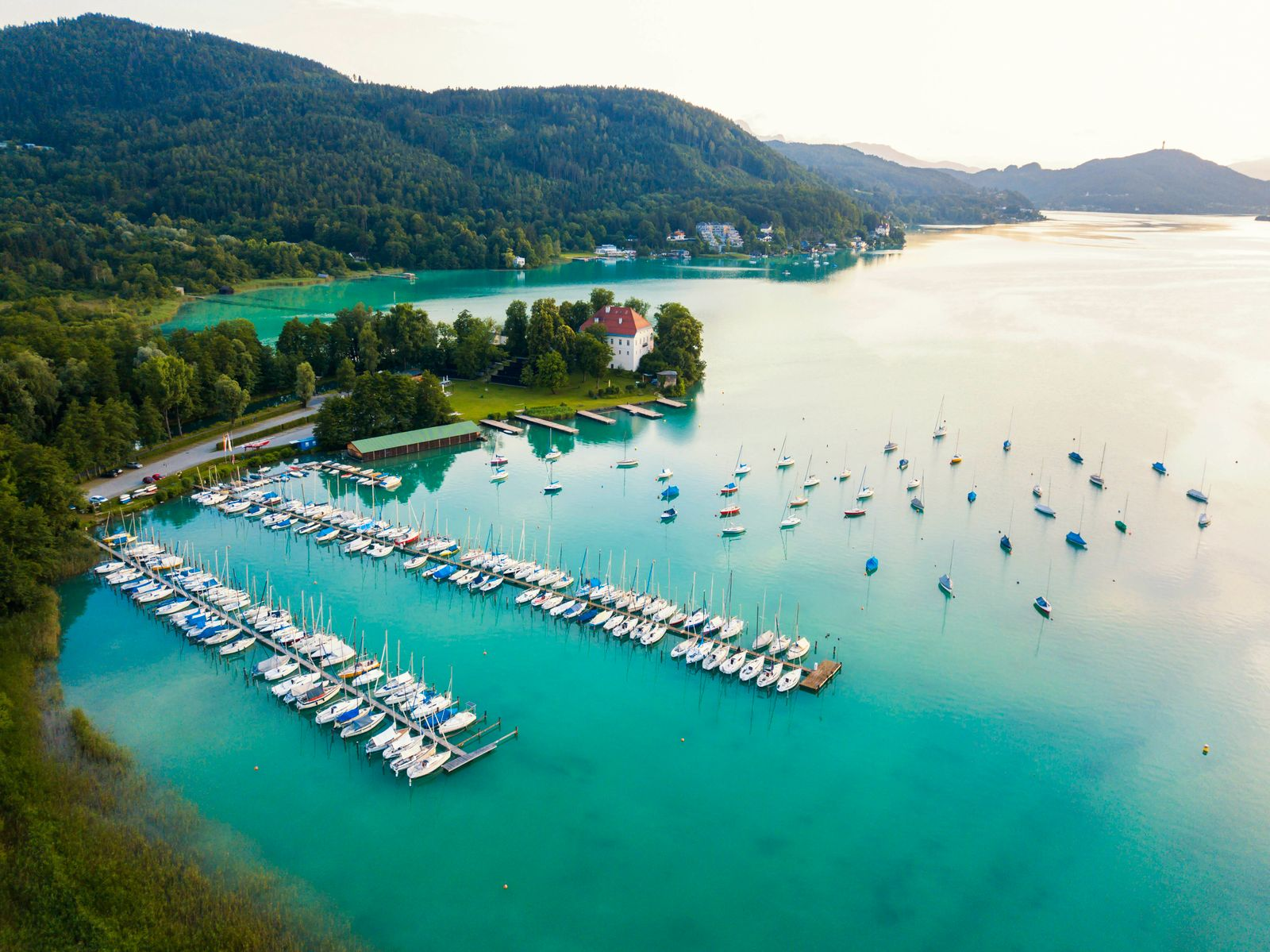 Aerial view of boats moored by jetty in Woerthersee at harbor against sky during sunset PUBLICATIONxINxGERxSUIxAUTxHUNxO