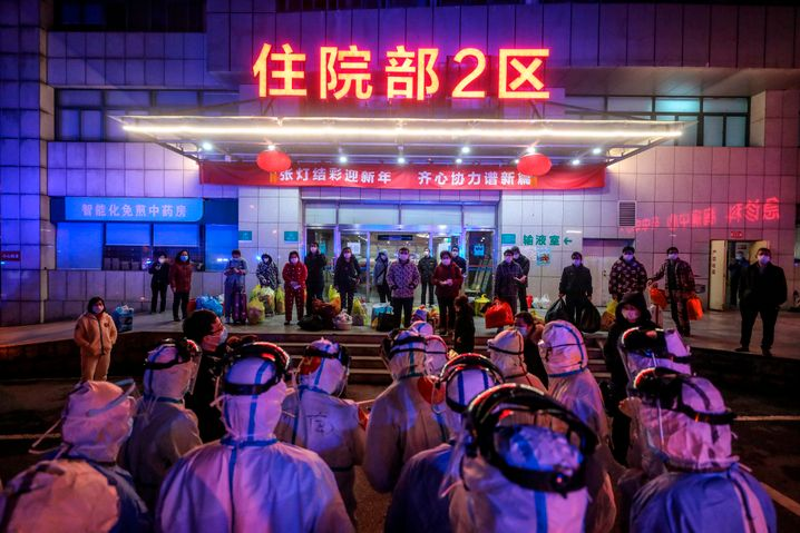 Patients waiting to be transfered to another hospital in Wuhan: The city also provided the blueprint for combating the pandemic.