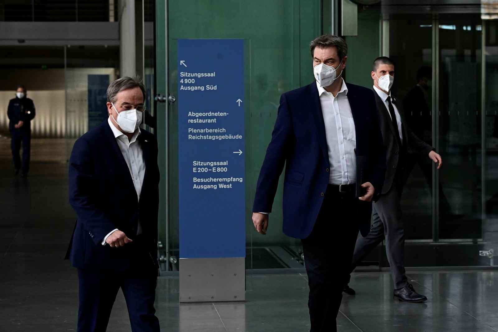 Armin Laschet and Markus Soder walk after a news conference in Berlin