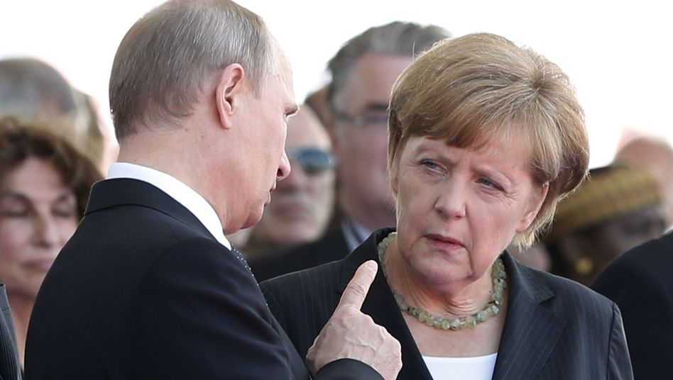 Russian President Vladimir Putin and German Chancellor Angela Merkel at the 70th anniversary of D-Day commemoration in June.
