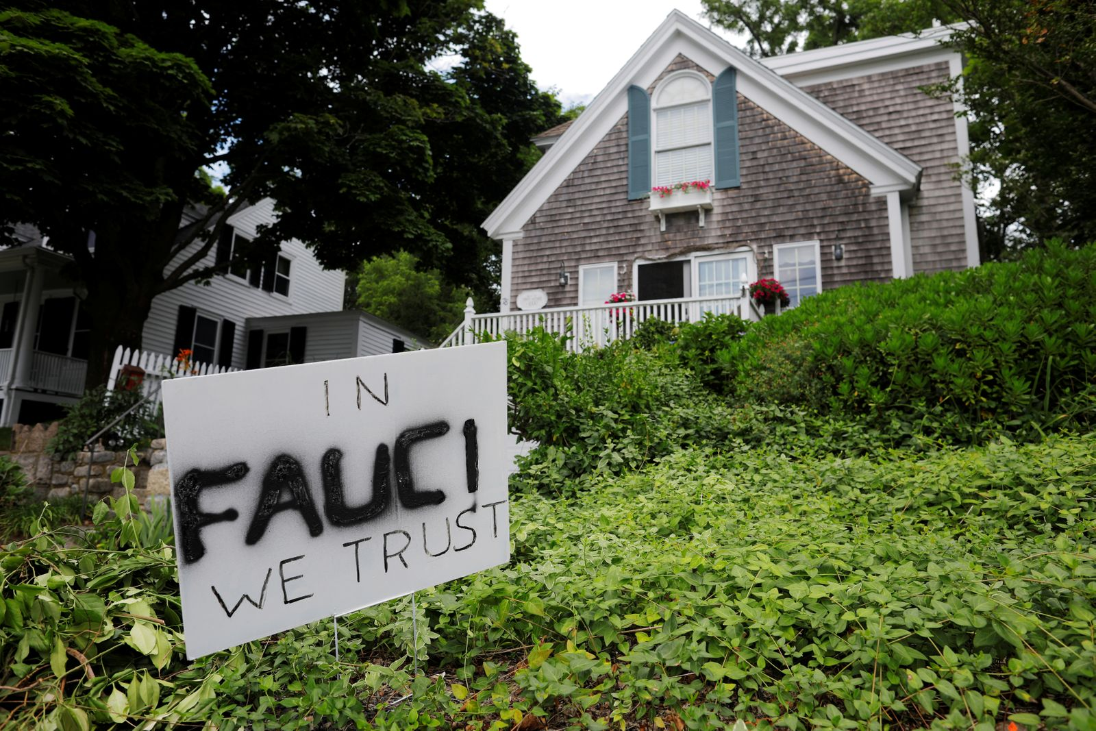 "A sign reads ""In Fauci We Trust"" in Rockport"