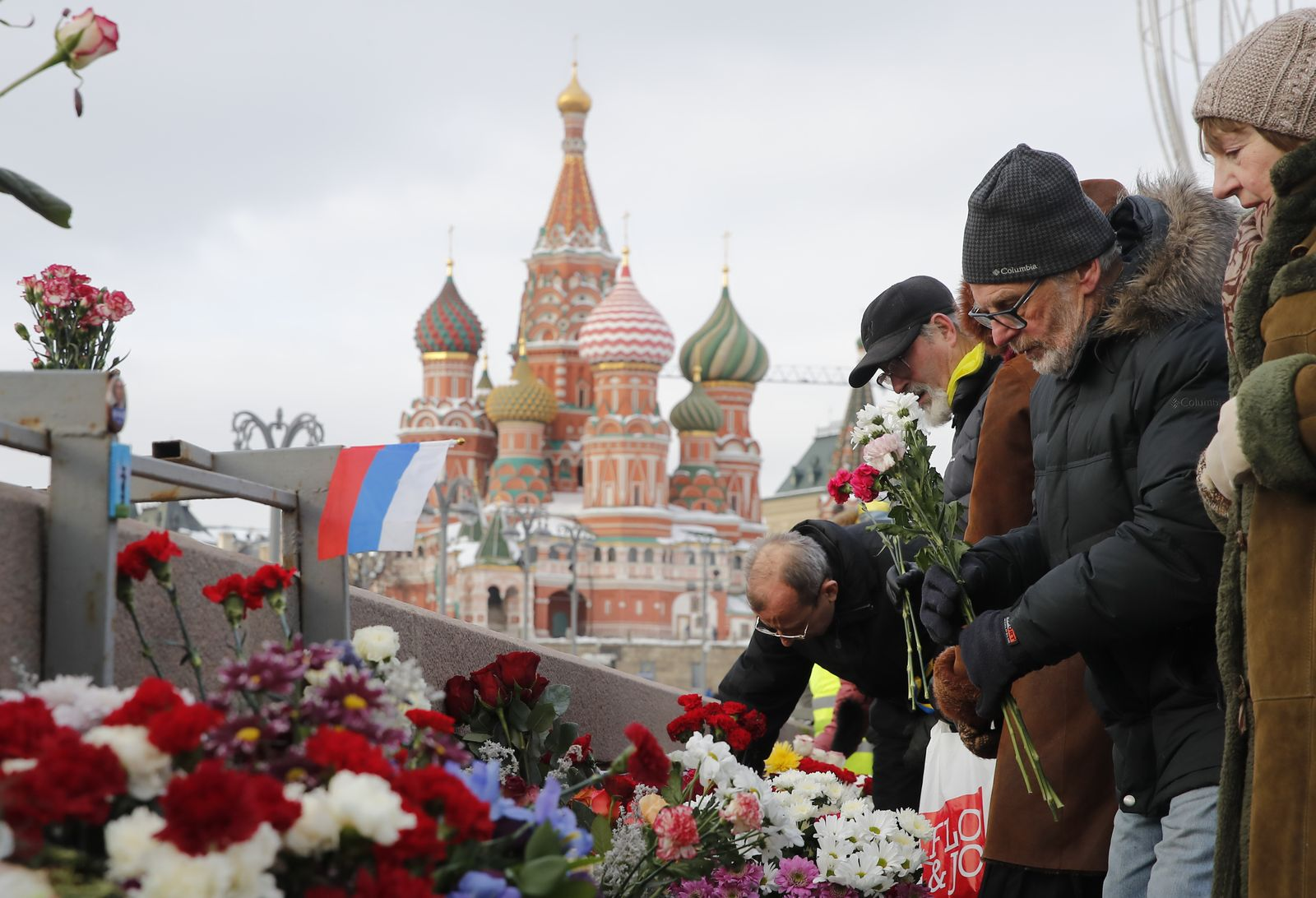 People visit the site of the assassination of Russian opposition leader Nemtsov in central Moscow
