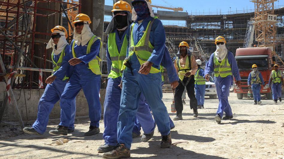 Gastarbeiter auf einer Baustelle in Doha: Geltende Gesetze werden schlicht ignoriert