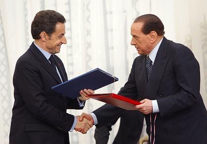 """Sarkozy (links), Berlusconi: """"Wir wollen, dass Atomkraft zu einer europäischen Frage wird"""""""