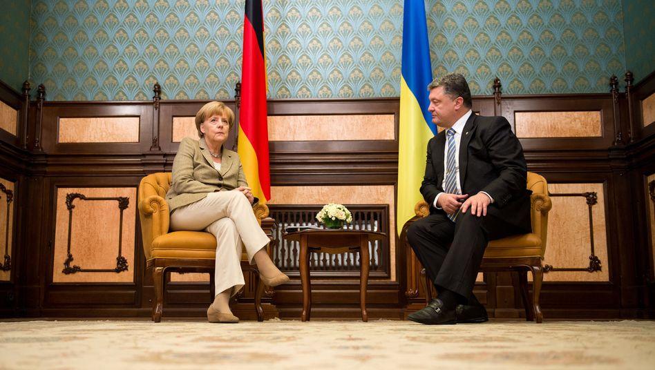 Bundeskanzlerin Angela Merkel und der ukrainische Präsident Petro Poroschenko im Präsidentenpalast in Kiew
