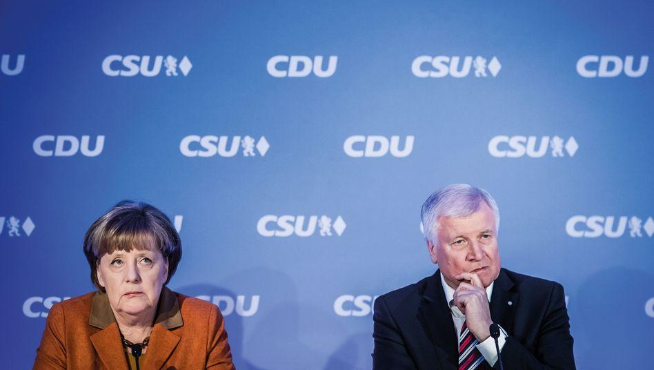 CDU-Chefin Merkel, CSU-Chef Seehofer
