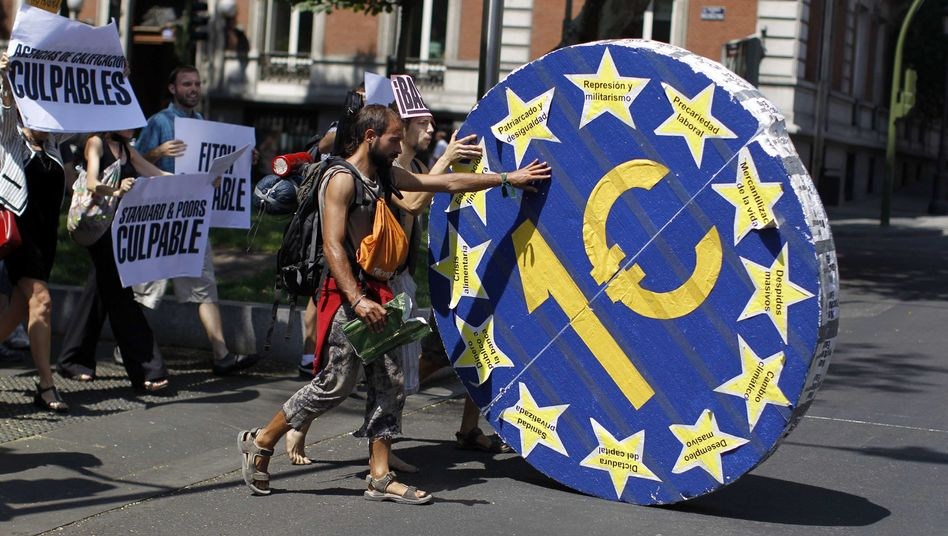 Demonstrators in Spain (July 2011). The fate of the banks and the euro are inextricably linked.