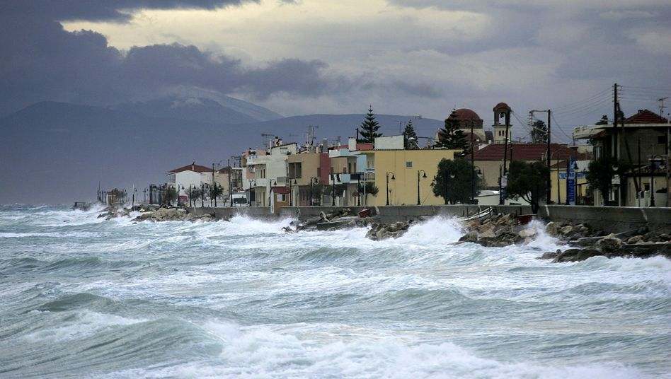 Waves hit the Greek city of Corinth. Sea levels have risen significantly in recent decades.