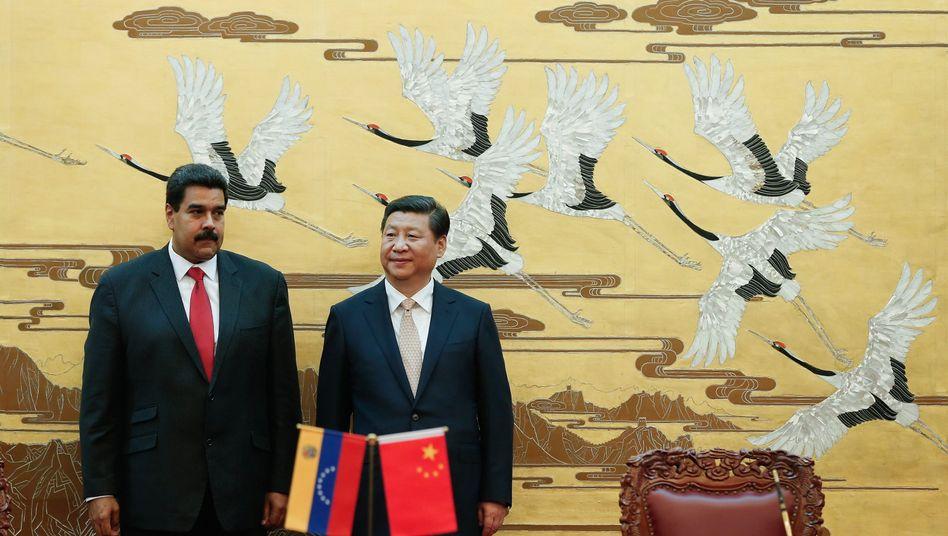 Präsidenten von Venezuela (l.) und China: Milliardenabkommen vereinbart