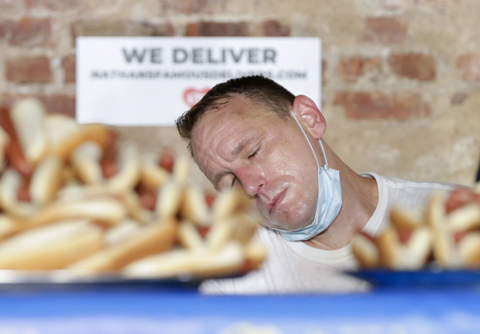 The 1-ranked eater in the world Joey Chestnut closes his eyes while waiting for the belt ceremony after winning the 104