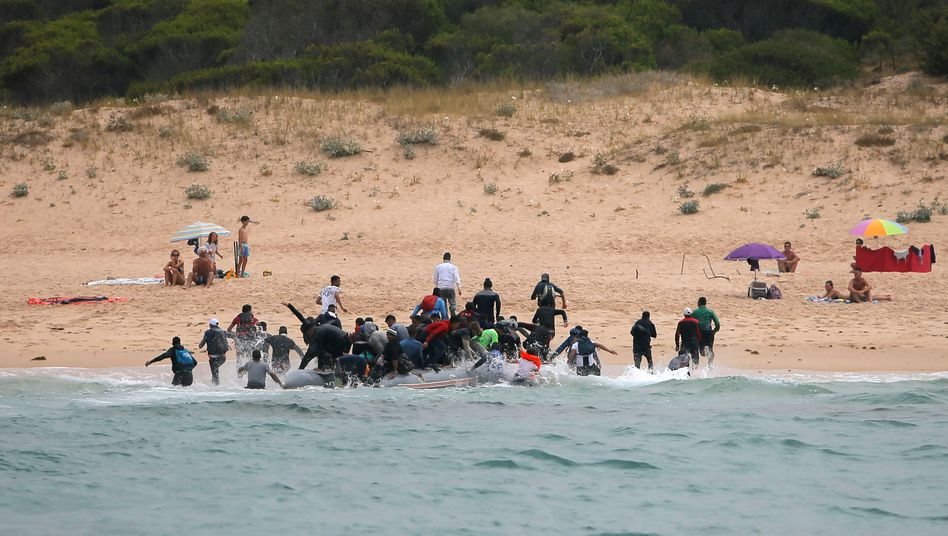 Migrants disembark at a beach in Tarifa, southern Spain after crossing the Strait of Gibraltar.