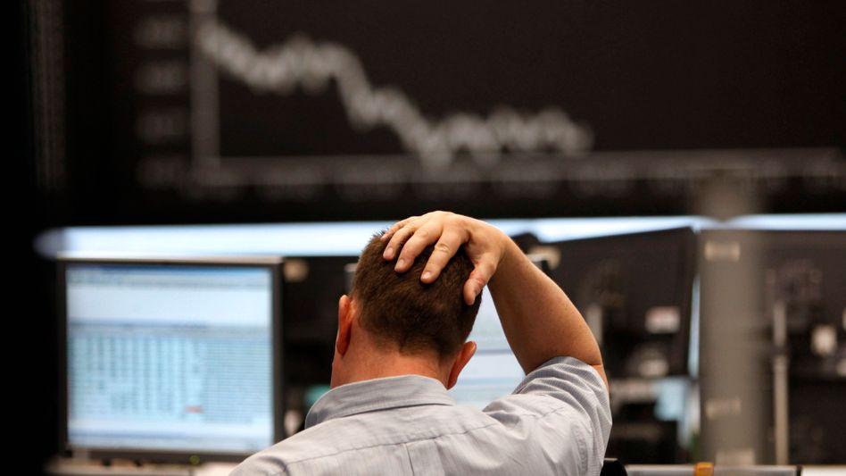 Börsenhändler in Frankfurt: Finanzmärkte misstrauisch