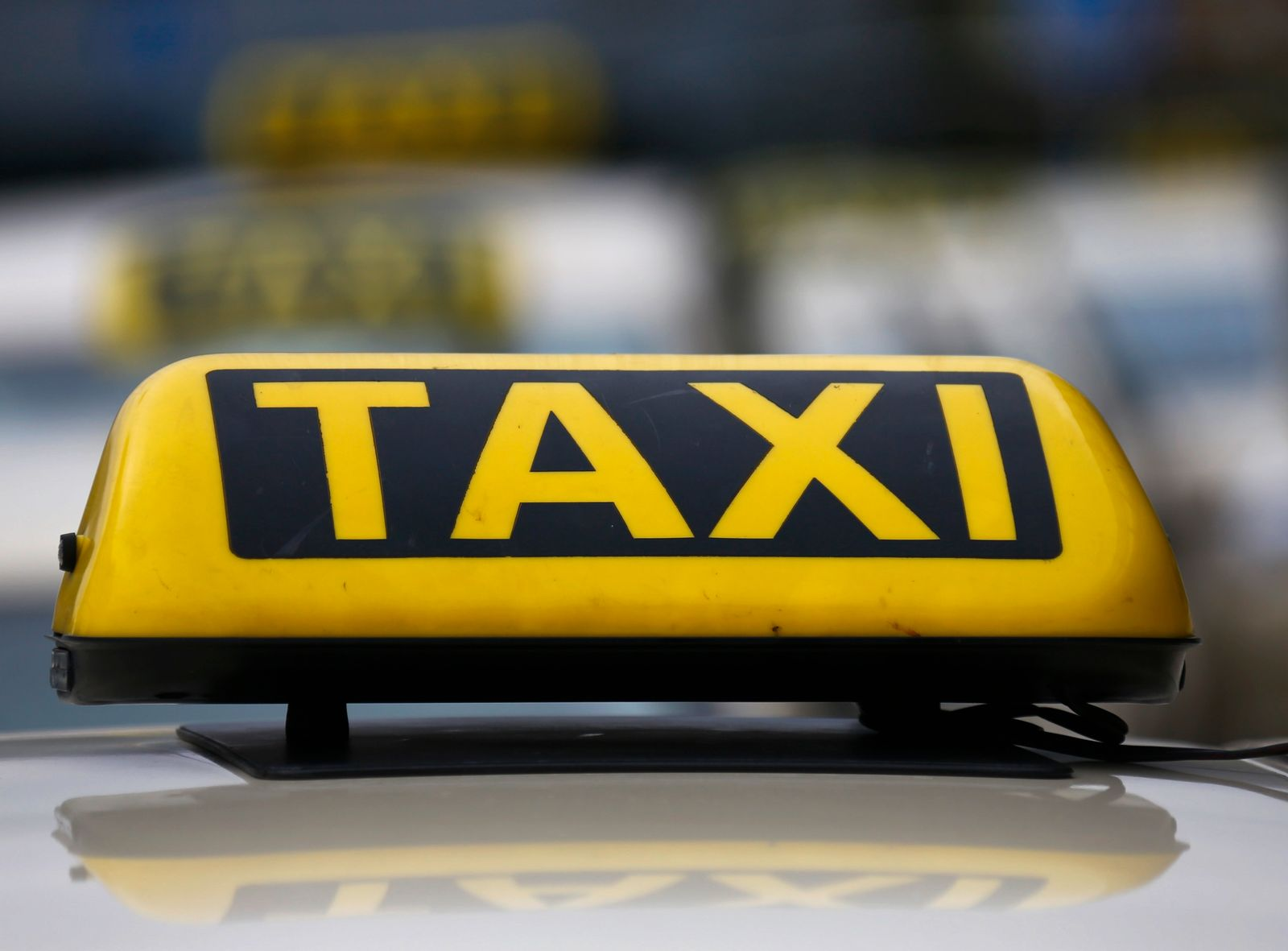 An official German taxi sign is seen atop of a taxi outside the airport in Frankfurt