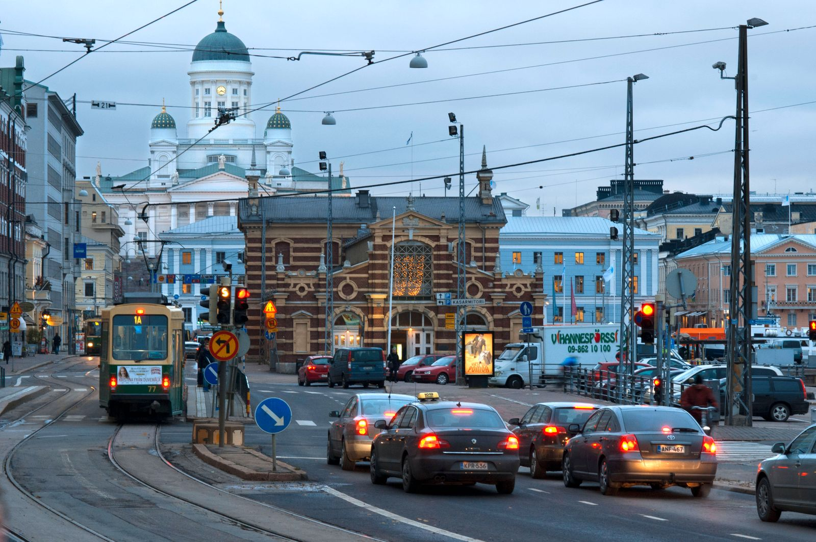 General view of the Helsinki city with the tram, market, and the Senaatintori Lutheran Cathedral from the Eteläranta str