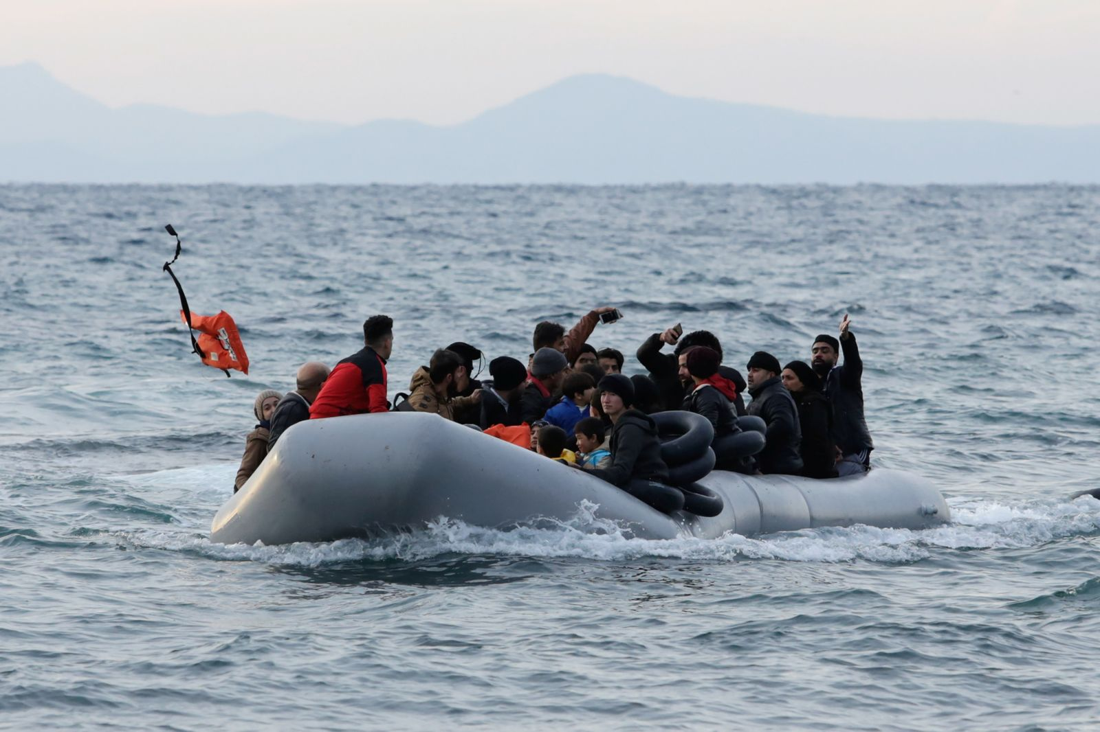 Migrants from Syria, Iraq, Afghanistan and Palestinian territories arrive on a dinghy near the city of Mytilene, after crossing part of the Aegean Sea from Turkey to the island of Lesbos