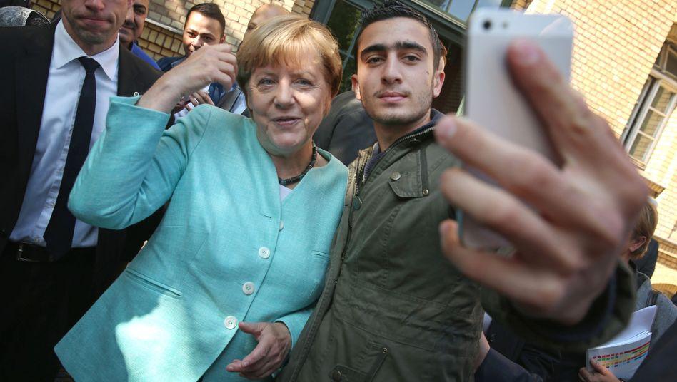 Merkel mit Modamani