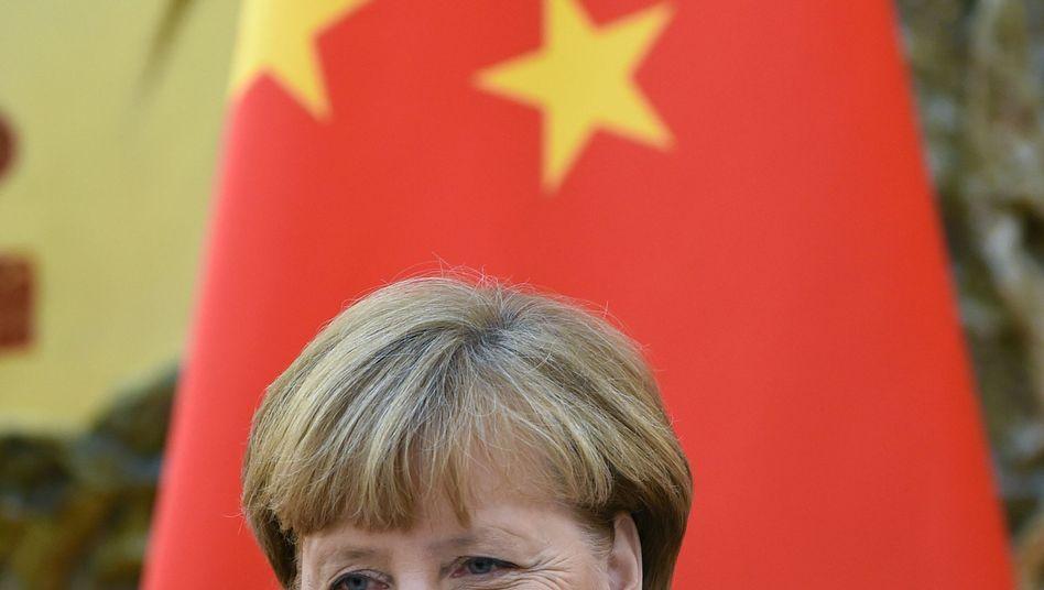 Merkel in Peking: Treffen mit Bloggern, Autoren, Menschenrechtsanwälten