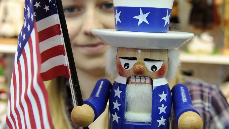 """""""Uncle Sam"""" als Nussknacker: Wer sich auf dem US-Arbeitsmarkt durchbeißen will, sollte mit einer guten Bewerbung beginnen"""