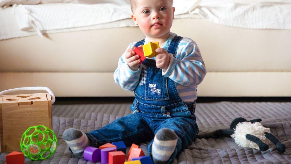 Kind mit Downsyndrom