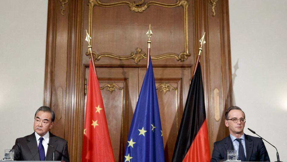 Heiko Maas und sein chinesischer Amtskollege Wang Yi im Februar bei einer Pressekonferenz im Auswärtigen Amt