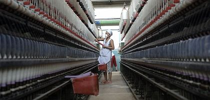 Gutierrez would like to see the US and Europe cooperate more closely on intellectual property. Here, an employee in a textile factory in China.