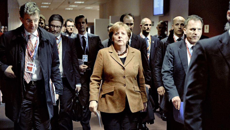 German Chancellor Angela Merkel arrives for a press conference at the end of a two-day European Union summit on March 2, 2012 at EU headquarters in Brussels.