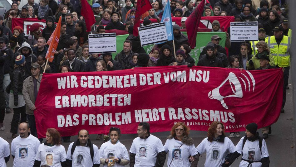 """The problem is called racism,"" reads a banner at a march in Berlin last November to commemorate the victims of the NSU."